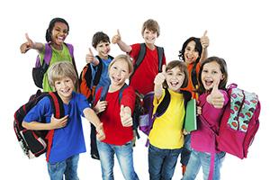 School children showing thumbs up.